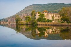 Beautiful shores of Kaifa lake and old ruined buildings and their reflections in water on Peloponnese in Greece. Image of beautiful shores of Kaifa lake and old stock image