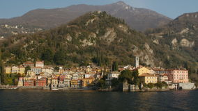 The beautiful shores of Lake Como with the town of Varenna. The beautiful shores of Lake Como with the town of Varenna and the Italian Alps in background. View stock footage