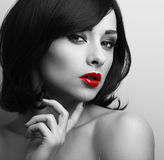 Beautiful short hair style woman with red lips looking sexy. Bla Royalty Free Stock Photos