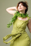 Beautiful short hair woman with green dress Stock Photo