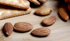 Almond nuts. Beautiful shot of almond nuts on wooden board royalty free stock photo