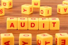 Audit. Beautiful shot of audit spelled with yellow blocks stock images