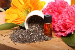 Chia seeds and oil bottle Stock Photos