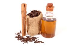 Clove and cinnamon oil. Beautiful shot of clove and cinnamon oil on white background royalty free stock photo