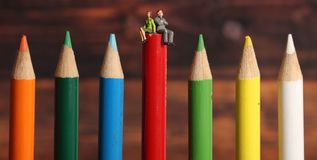 Colours. Beautiful shot of couple sitting on pencil colours stock images