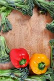 Vegetable frame. Beautiful shot of frame made from broccoli and bell-peppers Royalty Free Stock Photography