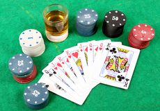 Gambling time. Beautiful shot of gambling items with whiskey glass royalty free stock photography