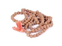 A garland of rudraksh beads. Beautiful shot of a garland of rudraksh beads on an isolated background Royalty Free Stock Photo