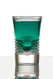 Beautiful shot glass back lit. With green drink Stock Photo