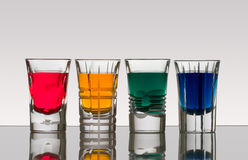 Beautiful shot glasses back lit. With colorful drinks Stock Image