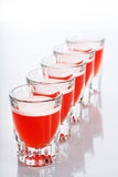 Beautiful shot glasses back lit. red Stock Photography