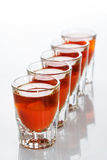 Beautiful shot glasses back lit. red Stock Image