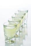 Beautiful shot glasses back lit. yellow Stock Photography