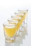 Beautiful shot glasses back lit. yellow Royalty Free Stock Image