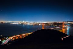 Beautiful shot of Golden Gate bridge taken from Hawk Hill. With light trails at night royalty free stock images