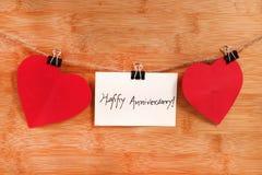 Happy anniversary. Beautiful shot of happy anniversary on wooden background stock photo