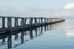 Beautiful shot of a long pier and the sea with cloudy sky stock photo