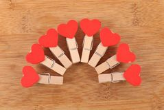 Love clips. Beautiful shot of love clips on wooden background royalty free stock photos