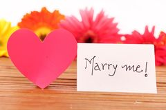 Marry me. Beautiful shot of marry me written on white chit royalty free stock photos