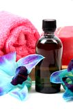 Spa oil. Beautiful shot of massage  oil with towel  on white background Royalty Free Stock Images