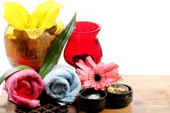 Spa towels and vitamins. Beautiful shot of massage towels with salt and vitamins Stock Photo