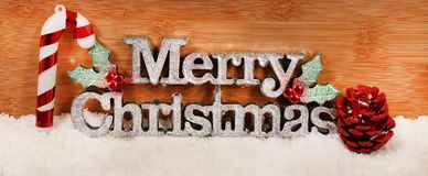Merry christmas. Beautiful shot of merry christmas badge on wooden background stock images
