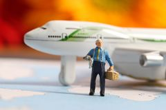 Traveller. Beautiful shot of miniature male with aeroplane in background Stock Images