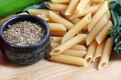 Pasta preparations. Beautiful shot of pasta with vegetables and seasoning Royalty Free Stock Photos