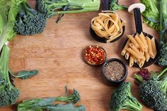 Pasta preparations. Beautiful shot of pasta with vegetables and seasonings Stock Photography