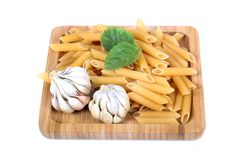 Penne pasta. Beautiful shot of penne pasta with garlic Royalty Free Stock Photos