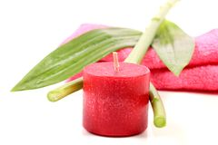 Spa candle. Beautiful shot of pink colored wax spa candle royalty free stock image