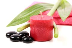 Spa candle. Beautiful shot of pink colored wax spa candle royalty free stock photo