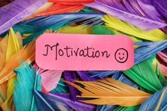 Positive motivation. Beautiful shot of positive motivation written on paper with background made of feathers stock photos