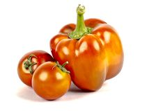 A red bell pepper and cherry tomatoes stock photography