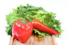 Red capsicum and chilly. Beautiful shot of red colored capsicum and chilly royalty free stock photo