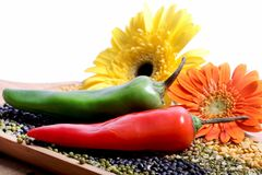 Chillies and lentils. Beautiful shot of red and green chillies on different types of lentils Royalty Free Stock Photo