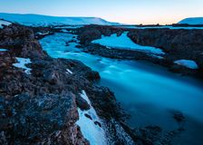 Beautiful shot of a river in a rocky field stock photos