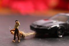 Car towing. Beautiful shot showing female towing damaged car stock images