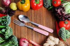 Vegetables and cutlery. Beautiful shot showing fresh vegetables with fork and spoon Royalty Free Stock Photo