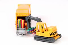 Loader toy. Beautiful shot showing miniature loader machine with paper clips as load Royalty Free Stock Photos