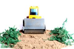 Road roller. Beautiful shot showing miniature road roller on soil Royalty Free Stock Photos