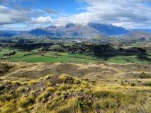 Beautiful nature New Zealand. Beautiful shot showing mountains and fields in New Zealand Royalty Free Stock Photos