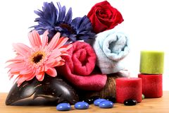 Spa towels. Beautiful shot of spa towels with flowers and candles stock photos
