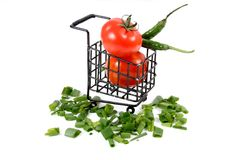 Tomatoes and chillies. Beautiful shot of tomatoes and chillies on white background Stock Image