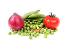 Tomatoes onion and green peas Stock Photo