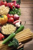 Pasta and ingredients. Beautiful shot of vegetables with pasta in background Royalty Free Stock Photo