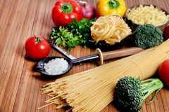 Pasta and ingredients Stock Photography