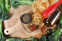 Pasta and ingredients Stock Photos