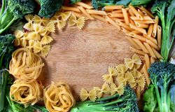 Wheat pasta frame. Beautiful shot of wheat pasta and vegetable frame Stock Image
