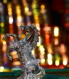 Horse Showpiece Object Photograph. The beautiful showpiece object with illuminated lights background. Glass made horse artificial object photo Stock Image
